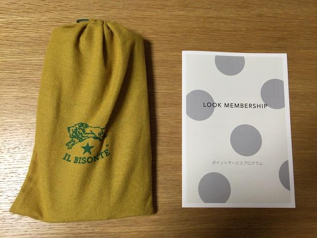 長財布を入れている巾着袋と公式LOOK MEMBERSHIPの内容